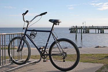 bicycle parked in a bike rack along the Florida coastline