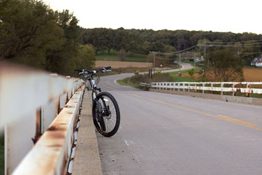 mountain bike parked on a bridge in rural Iowa