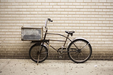 courier bicycle, with brick wall background, in Manhattan, New York City